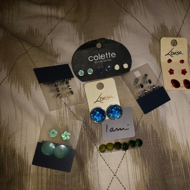 Earrings, both studs and dangly And packets of earrings.