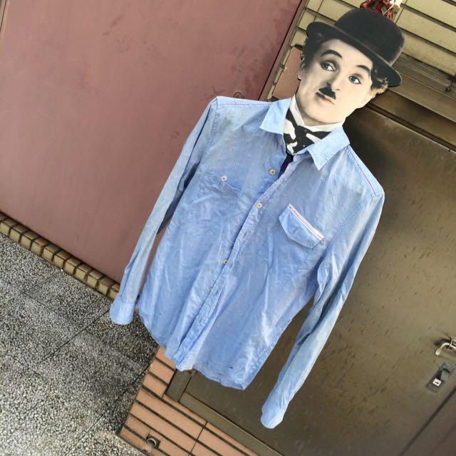 服飾店淺藍色薄不對稱口袋古著襯衫