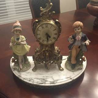 Antique Clock And Statue.