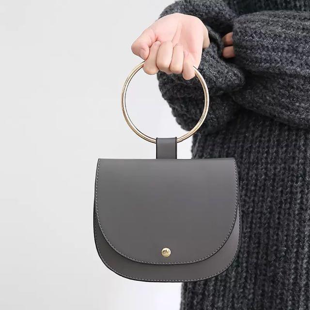 歐美風金屬手環包純色手提包