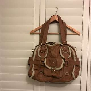 Genuine Colette Tan Bag With Fur Piping And Gold Buckles