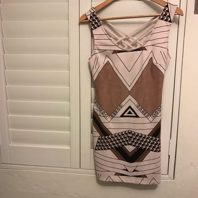 Various Aztec Designs Dress/Top In Browns, Beiges & Black.