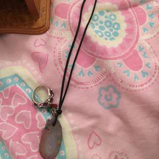 mood stone necklace with a purple and pink crystal ring