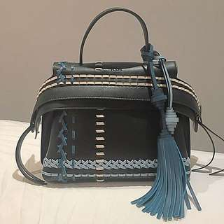 100% Authentic Tod's Convertible Wave bag stitched Leather mini