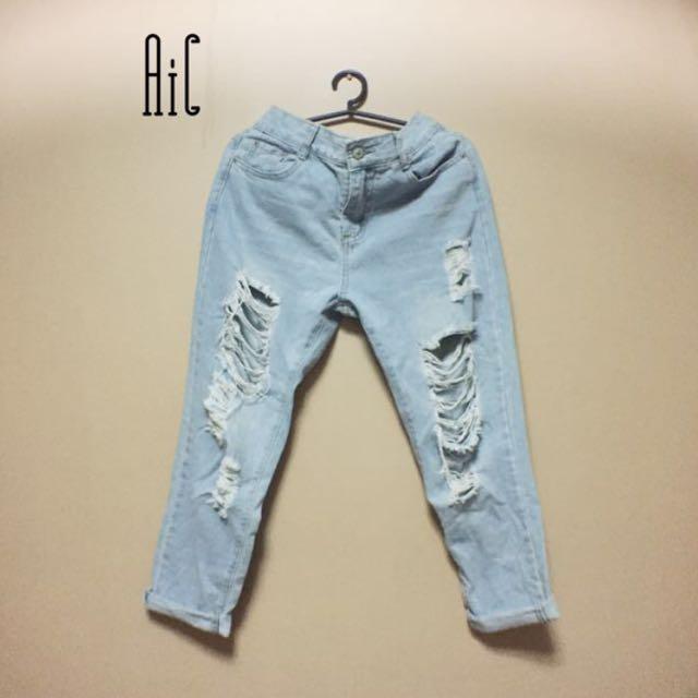 Boyfriend's ripped jeans