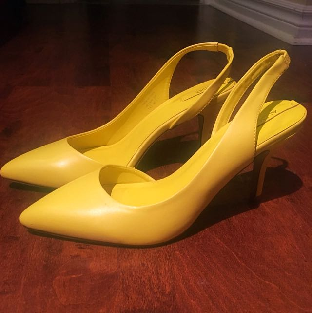 Yellow Aldo Sling back Heels