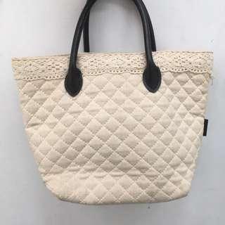 日本帶回米白手提包