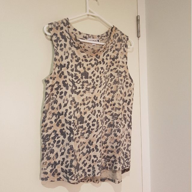 Leopard print sleeveless top with gold studs