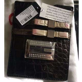 original guess passport holder
