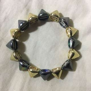 SPIKED GREY AND GOLD BRACELET