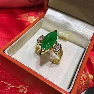 "Grade ""A"" marquis cut jadeite ring set in 18KYG."