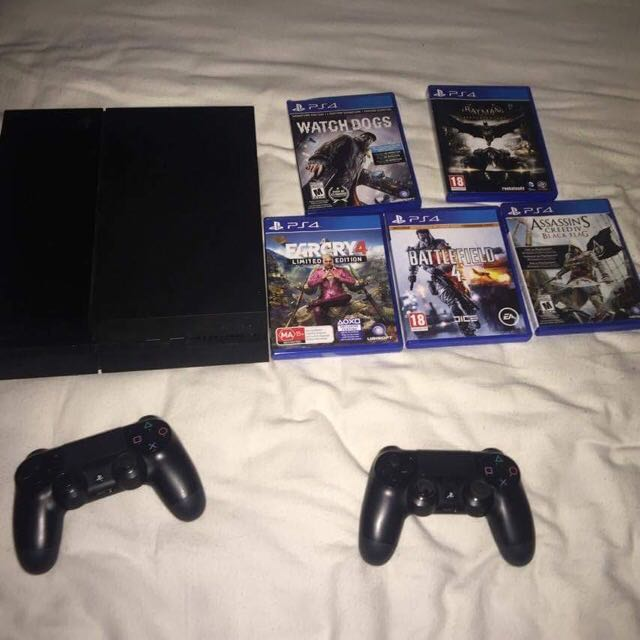 Sony 500GB PlayStation 4 PS4 Black With 2 Controllers And 5 Games
