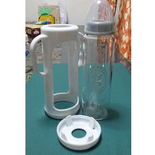 Glass feeding bottle with teats