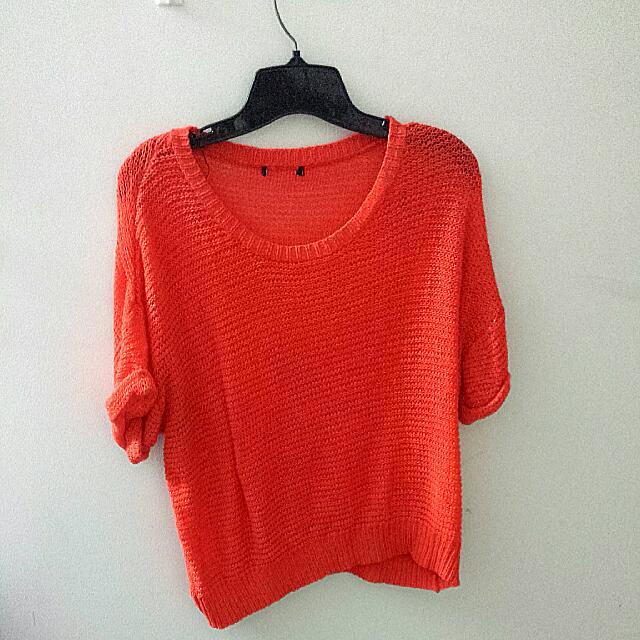 orange knitted sweater