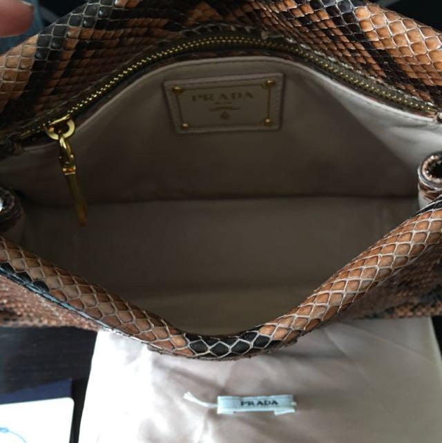 3318bd6108c780 Prada Python Pochette, Luxury, Bags & Wallets on Carousell