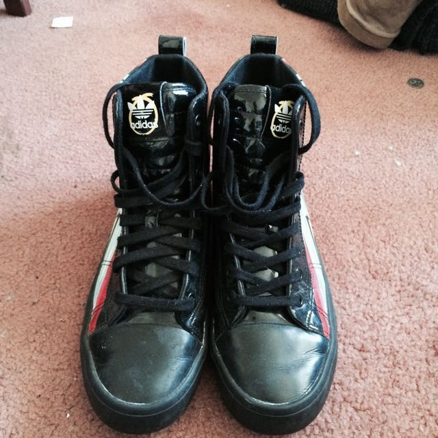 Adidas High Top Skull Themed Shoes.