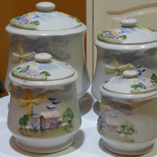 4 different sizes of jars with covers 1 set