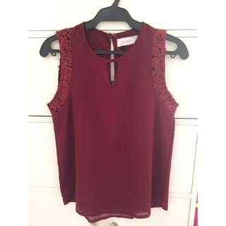 Maroon sleeveless blouse