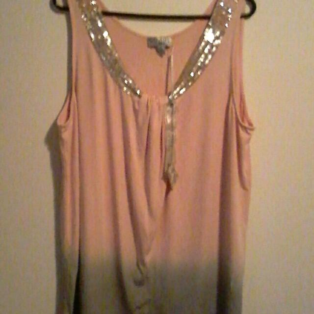 Elegant top with sequence detail.