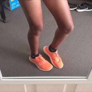 Orange Nike Free Runs