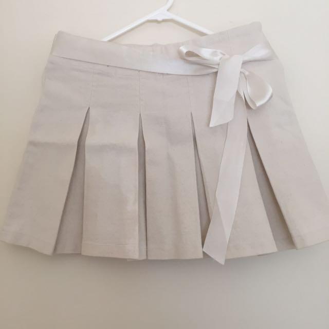 Ivory Bow Pleated Mini Skirt