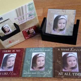 glass photo coasters set in wooden cradle