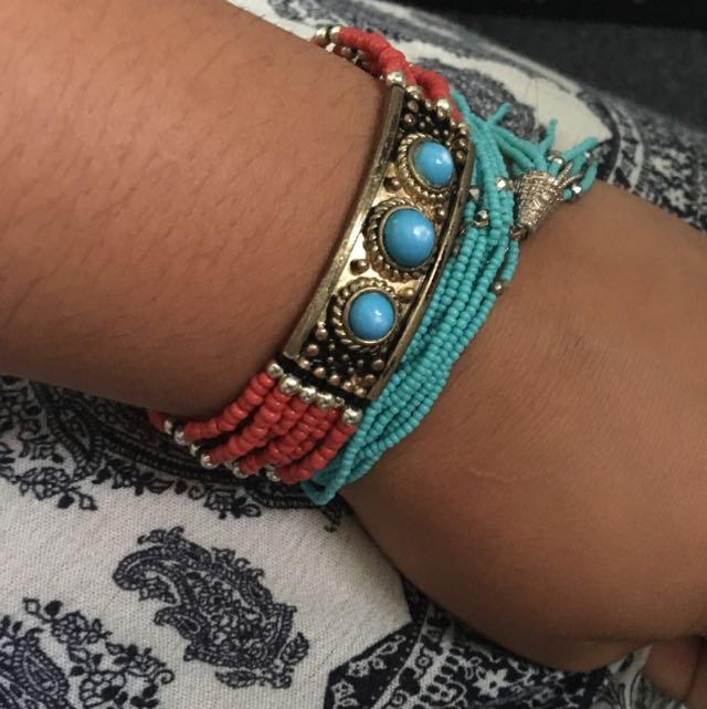Light blue bracelet with tussle and red and blue tribal designed bracelet