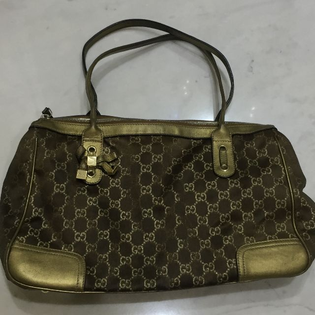 Gucci bow gold bag