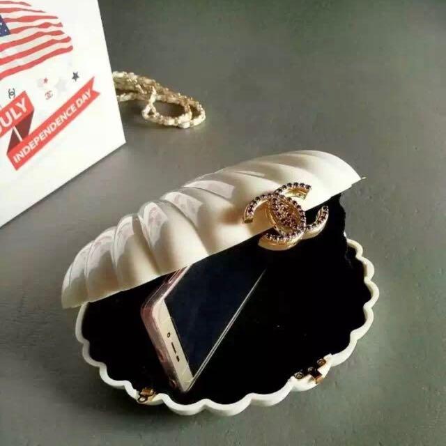 White clamp sea shell design chanel purse