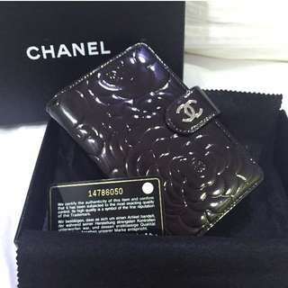 CHANEL Black Camellia Embossed Wallet