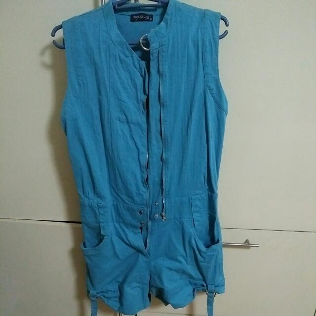 Folded and Hung Blue Green Jumpsuit Shorts