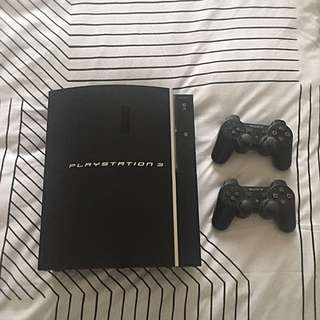 Sony PlayStation 3, Plus 2 Controllers & 3 Games Free