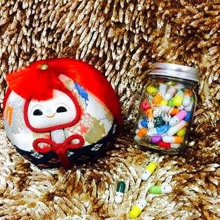 emoji capsules in a jar