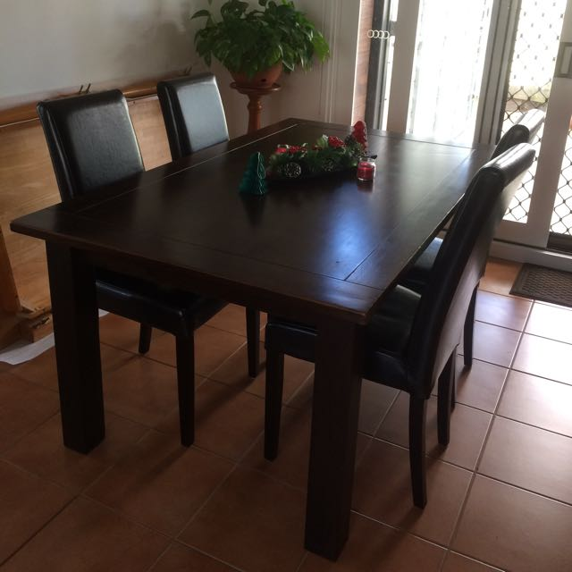 Chocolate brown wooden Dining Table & 4 vinyl Chairs