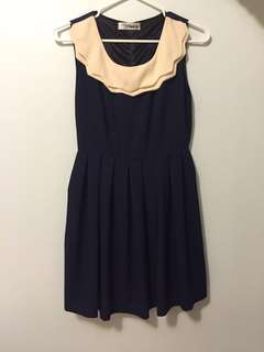 Navy blue dress with cream collar