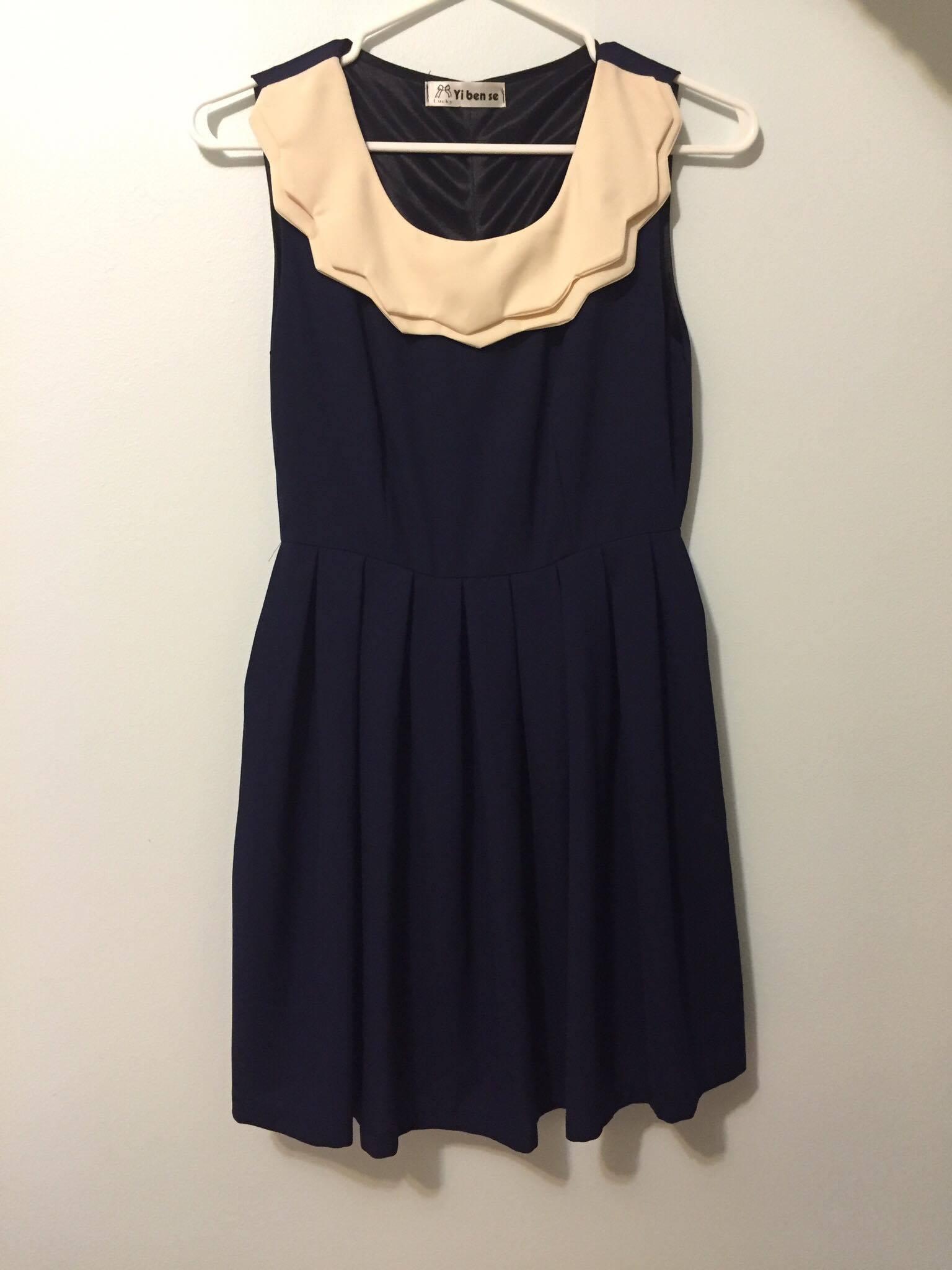 Navy blue dress with cream collar