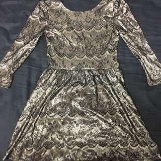 Knee Length Metallic Gold Dress.
