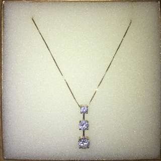 24 carat gold necklace with pendant