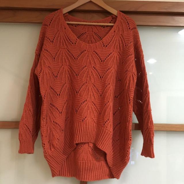 橘色毛線衣
