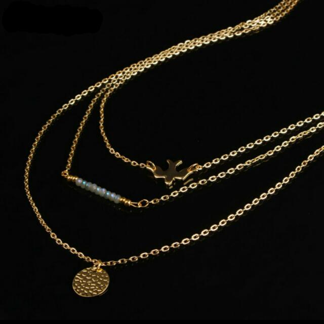 Gold Bird, Bar, and Coin Layered Necklace