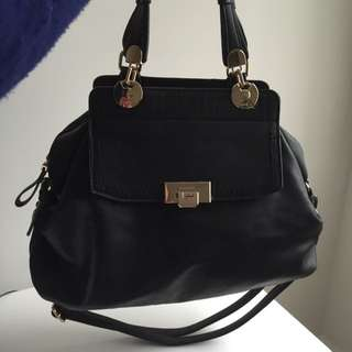 Black And Gold Gussaci Leather Handbag