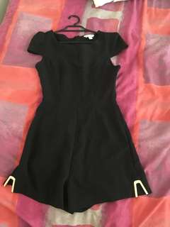 Black playsuit with gold metal on thighs