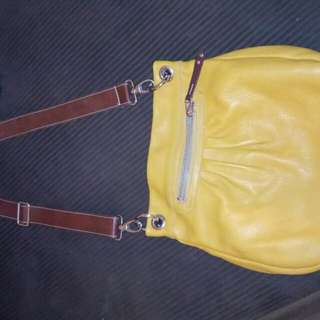 REDUCED-ROOTS LEATHER PURSE