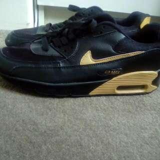 Gold Nike Air Maxs
