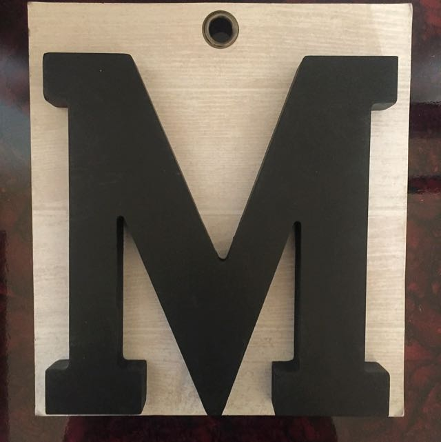 Decorative letter 'M'