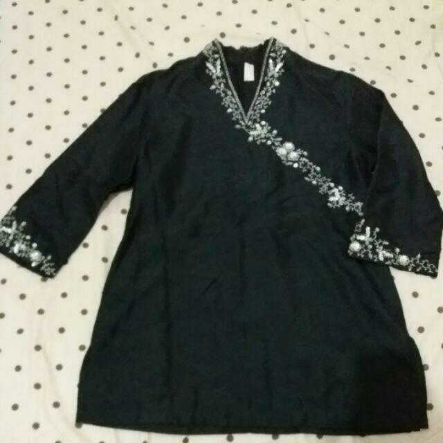 Sepasang Baju Muslim