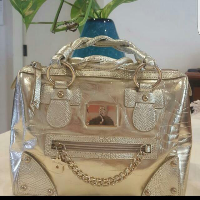 Paris hilton Gold Bag