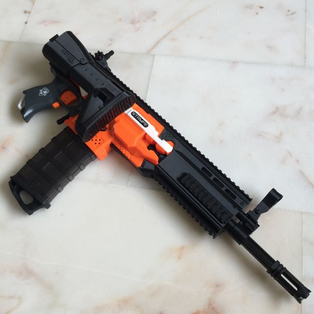 ( Sold Out )SCAR conversion Kit With Foldable Butt Stock For Nerf Stryfe,  Toys & Games, Bricks & Figurines on Carousell