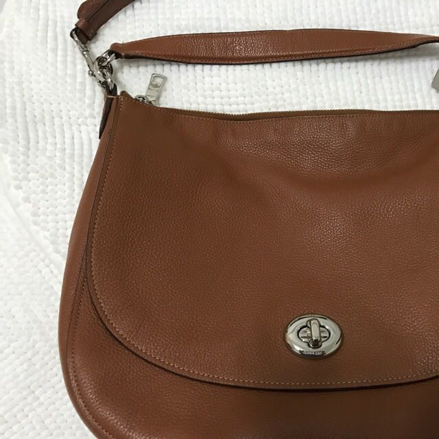 Coach Turnlock Hobo Bag In Saddle color c548d127aa759