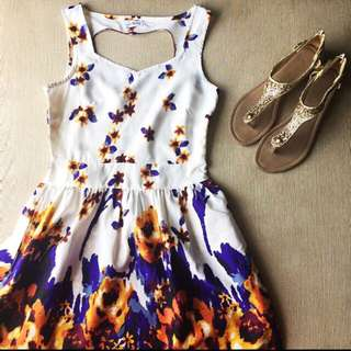 White Floral Dress With A Haert Shaped Design At The Ba K
